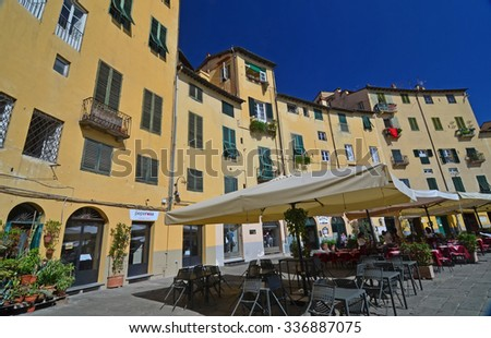 LUCCA, ITALY - SEPTEMBER 21: Restaurants, beautful architecture and colors in the often filmed Piazza Amfiteatro in Lucca, Italy - stock photo