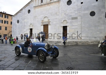 LUCCA (LU), ITALY - MAY 16: A blue Bugatti T40, driven by Juan Tonconogy and Guillermo Berisso, takes part to the 1000 Miglia on May 16, 2015 in Lucca (LU). The car was built in 1927 and won the race. - stock photo
