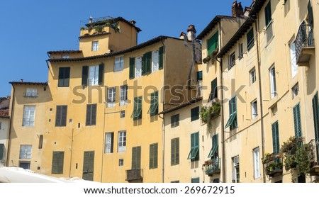 Lucca (Tuscany, Italy), the famous medieval square known as Piazza Anfiteatro - stock photo