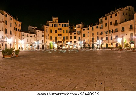 Lucca - view of StLucca - Piazza Anfiteatro at night. Tuscany, italy. Martin's Cathedral - stock photo