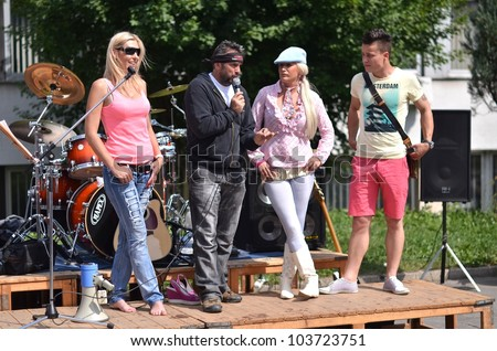 LUCENEC, MAY 28: Celebrities from Reality Show FARMA during BIKE PARTY HALIC 2012, on May 28, 2012 in Lucenec, Slovakia - stock photo