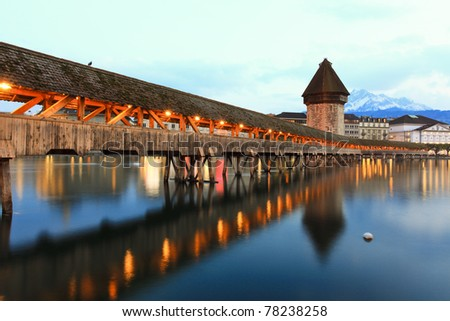 LUCERN, SWITZERLAND - APRIL 14:The Chapel Light show at dusk, closeup on April 14, 2011 in Lucern.The Chapel Bridge is a 204 m (670 ft) long bridge crossing the Reuss River in the city of Lucerne in Switzerland.