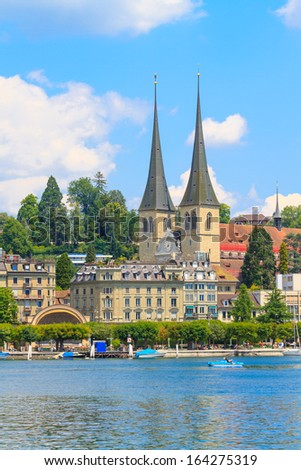 Lucerne city view with river Reuss and court church of St. Leodegar, Switzerland - stock photo