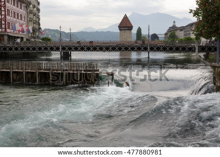 LUCERNE, SWITZERLAND - MAY 11, 2016: Needle Dam in the river Reuss. Weir was designed to use of thin wooden needles that can be added or removed by hand to maintain the level of water in Lake Lucerne