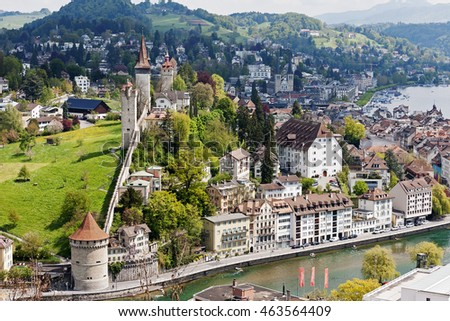 LUCERNE, SWITZERLAND - MAY 04, 2016: Towers of Lucerne's ancient city walls that are historic fortifications of the city are called Musegg and are mostly very well preserved