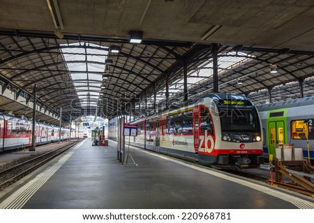 LUCERNE, SWITZERLAND - SEP 16, 2014: Lucern central train station. Due to its location on the shore of Lake Lucerne within sight of Swiss Alps, Lucerne has long been a destination for tourists. - stock photo