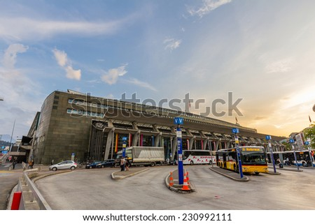 LUCERNE, SWITZERLAND - SEP 16, 2014: Lucerne train station and bus station located together. It is a major hub of the rail network of Switzerland, in the city of Lucerne in the canton of Lucerne.  - stock photo