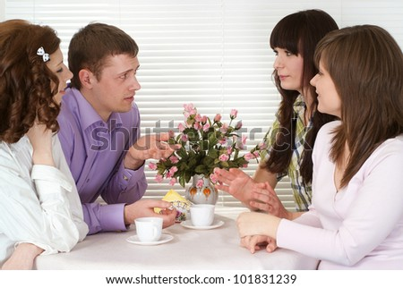 Luck Caucasian charming company of four men sitting at a table in a cafe - stock photo