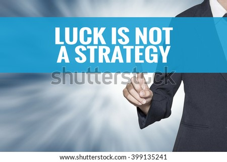 Luck Is Not a Strategy word on virtual screen touch by business woman cyan sky tab - stock photo