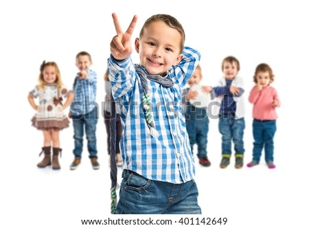 Lucky boy on a wooden chair over white background  - stock photo