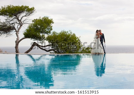 Lucky bridegroom and bride - stock photo