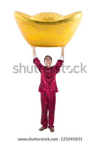 lucky chinese new year man with super gold nugget - stock photo