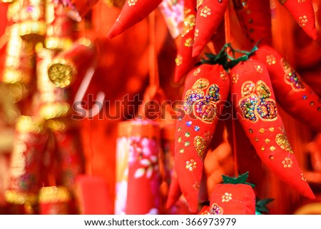 Lucky Chinese spicy red pepper decorations. They bring luck to your home and business. It means that something is booming. Your business will go up and up and will have a big success. - stock photo