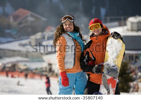 Lucky couple  snowboarders  in a mountain valley - stock photo