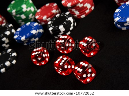 Lucky dice all come up six winning a lot of casino chips. - stock photo