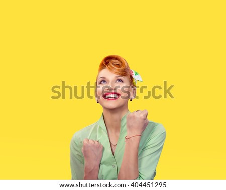 Lucky girl. Closeup portrait happy young woman happy exults pumping fists ecstatic isolated yellow wall background. Celebrate success concept. Human facial expression emotions feelings body language - stock photo