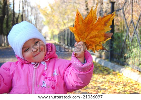 Lucky girl with autumn leafs - stock photo