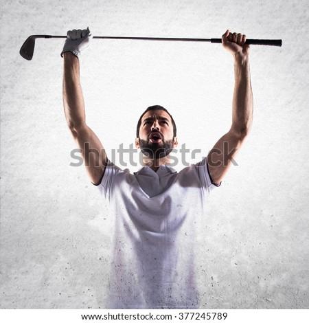 Lucky golfer man - stock photo