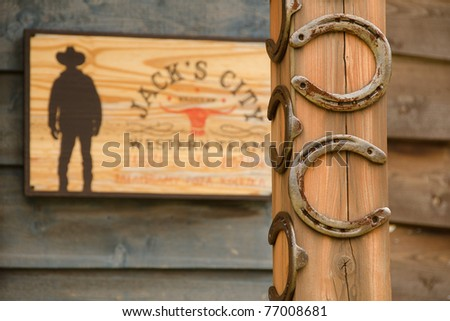 lucky horseshoes in front of western bar - stock photo