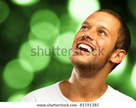 lucky man looking up on a lights background - stock photo
