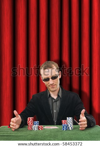 lucky man playing poker in casino - stock photo