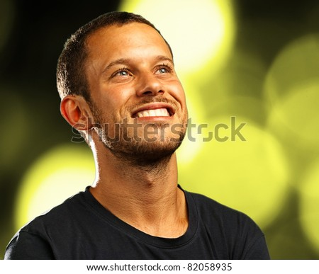 lucky man with a green light as a background - stock photo