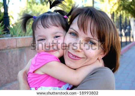 Lucky Mother and daughter - stock photo