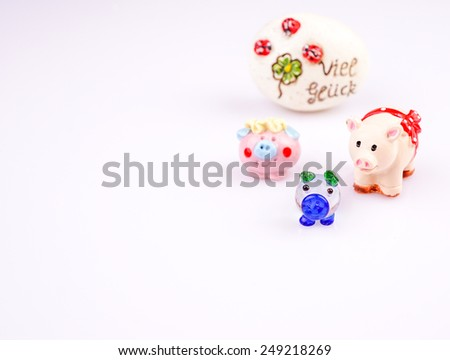 lucky pigs with a stone - stock photo