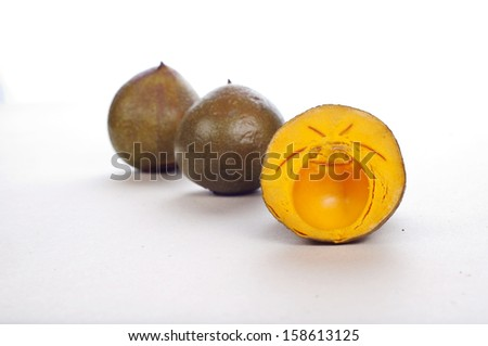 lucuma, delicious and tasty lucuma fruit against a white background