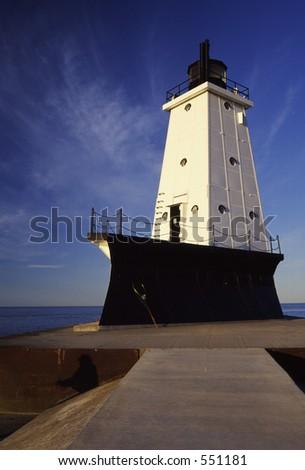 Ludington Lighthouse and beach on Lake Mighigan. - stock photo