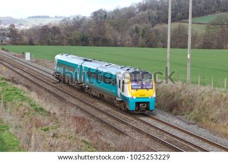LUDLOW, UK - FEBRUARY 24: An Arriva operated class 175 DMU express train passes through the Shropshire hills heading towards South Wales on February 24, 2017 in Ludlow