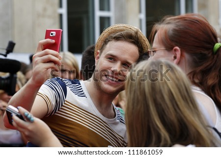 LUDWIGSBURG - AUGUST 29: Musician Olly Murs, many national and international superstars from the music scene in the Forum Theatre celebrated in Ludwigsburg, Germany. August 29, 2012.