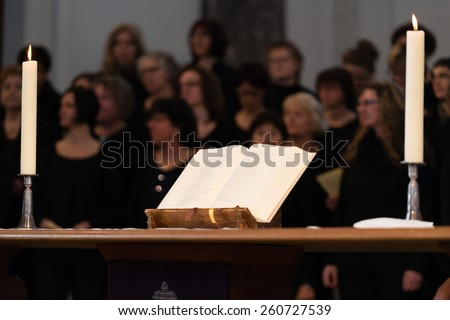 LUDWIGSBURG, GERMANY - MARCH 8, 2015: The church choir The Voices Of Peace perform during the worship service in the Friedenskirche - Peace Church - on March 8, 2015 in Ludwigsburg, Germany. A bible - stock photo
