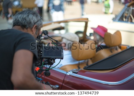 LUDWIGSBURG, GERMANY - MAY 5: A Mercedes-Benz classic car is filmed by a camera operator during the eMotionen show on the market square on May 5, 2013 in Ludwigsburg, Germany.