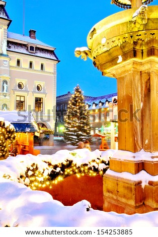 Lueneburg, Germany: illuminated, old town-hall with christmas tree at famous christmas-market.  - stock photo