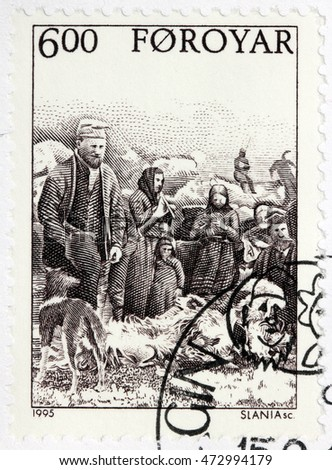 LUGA, RUSSIA - JUNE 25, 2016: A stamp printed by FAROE ISLANDS shows Faroese peasants fleecing sheep in farm, circa 1995.