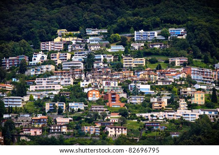 Lugano city houses on the hill - stock photo
