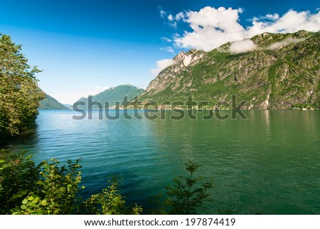 Lugano lake and mountains landscape. Photo taken in Porlezza, Lombardy, Italy.