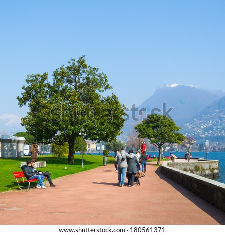 LUGANO, SWITZERLAND - MAR 8, 2014: Walking alley in Lugano, Switzerland. Lugano is the largest city of Ticino canton.