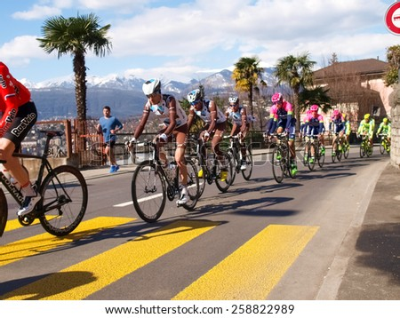 "Lugano, Switzerland - March 01, 2015: Cycling race ""Grand Prix of Lugano in 2015,"" This is the 69th edition and takes place along the streets of the city on the banks of Lake Lugano. - stock photo"