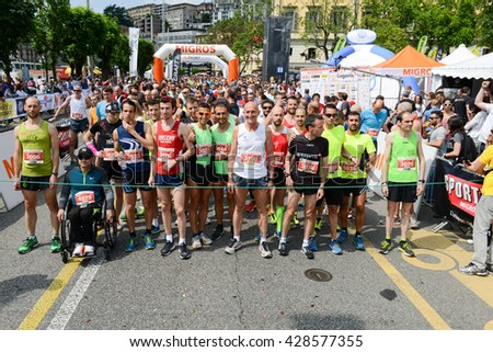 Lugano, Switzerland - 22 may 2016: Marathon runners packed tightly together right out of the starting line of StraLugano half marathon.