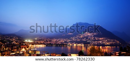 Lugano, Switzerland. Panoramic view of Lugano at night.