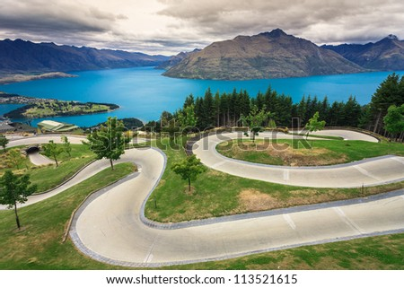 Luge track with beautiful lake and mountain at Skyline, Queenstown, New Zealand - stock photo
