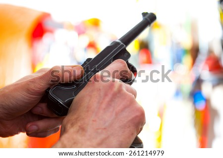 Luger Parabellum automatic pistol in a hands, shallow depth of field. close-up - stock photo