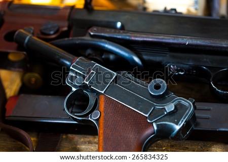 Luger Parabellum pistol and submachine gun MP 38 in gunsmith - stock photo