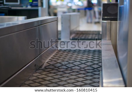 Luggage accept terminal with baggage handling belt conveyor system at check in desk in airport - stock photo