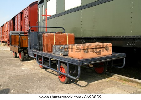 Luggage at the trainstation on a cart - stock photo