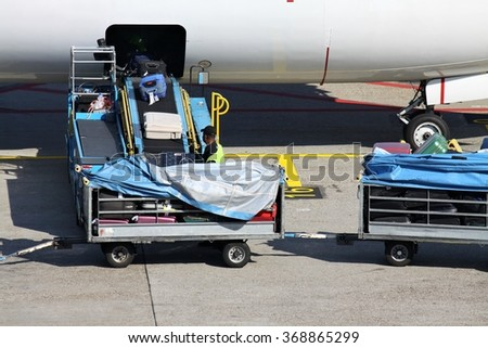luggage being loaded into airliner - stock photo