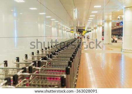 luggage carts at modern airport - stock photo