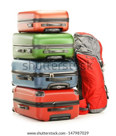 Luggage consisting of large suitcases and rucksack isolated on white - stock photo